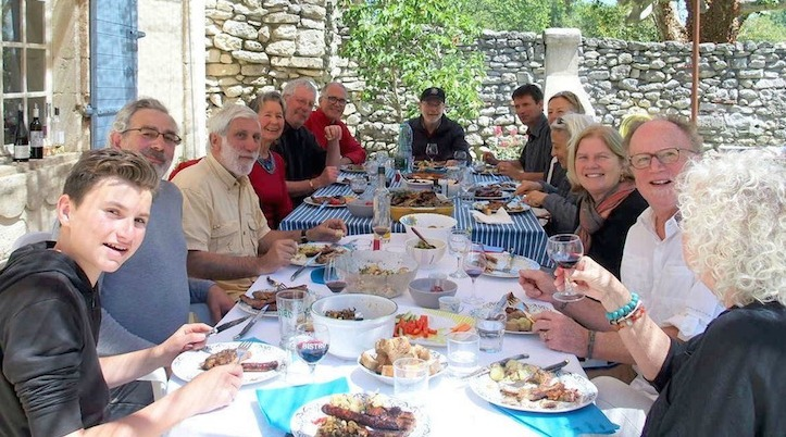 Outdoor dining table with Keith and friends enjoying lunch in France