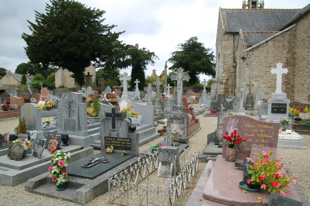 French village cemetery with flowers for All Saint's Day, France