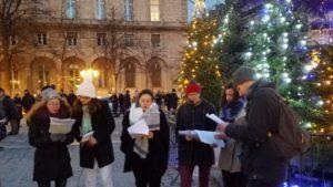 Christmas carol singers at Notre Dame, Paris, France