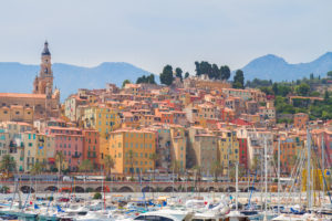 Colorful houses of Menton old town embankment, France
