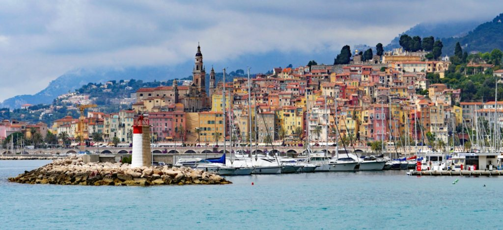 Menton, France with harbour of yachts and colourful buildings
